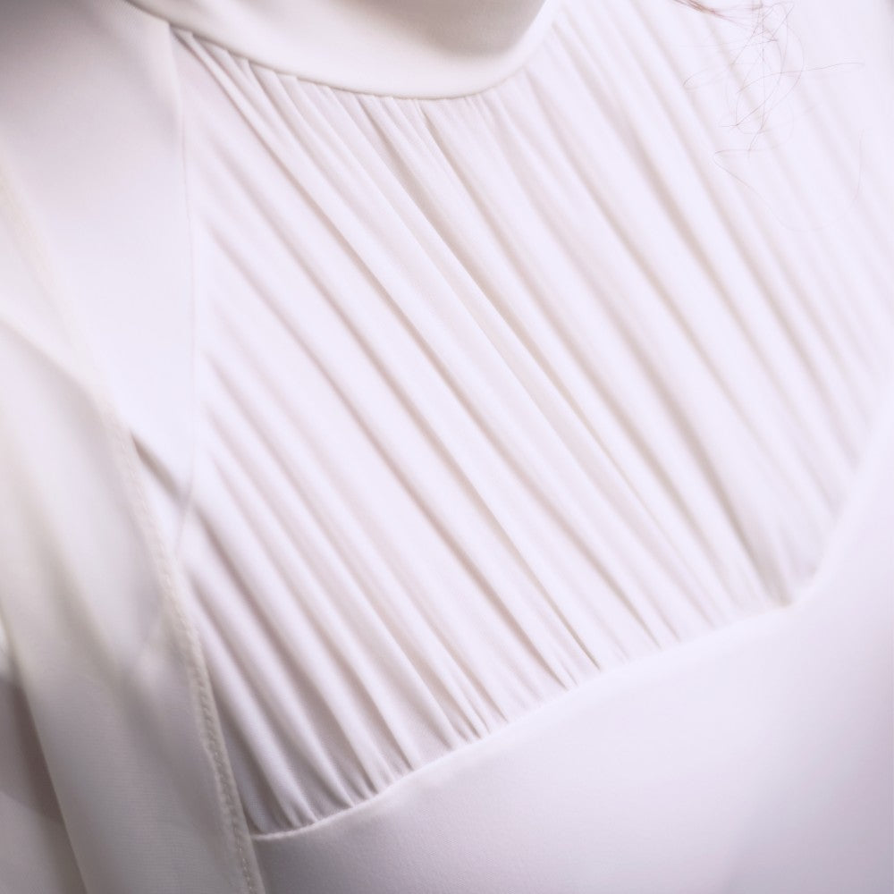 Detail of the Julieta leotard in white Aisy Dance made with ECONYLu00ae regenerated nylon