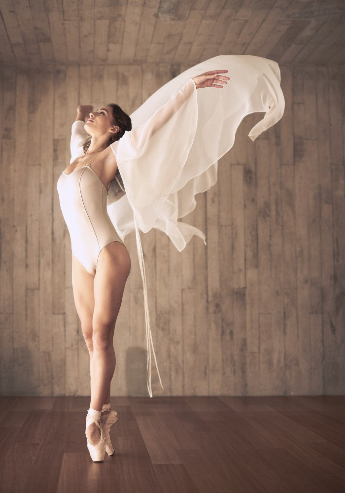 Dancer wearing the Titania leotard in taupe Aisy Dance made with ECONYLu00ae regenerated nylon