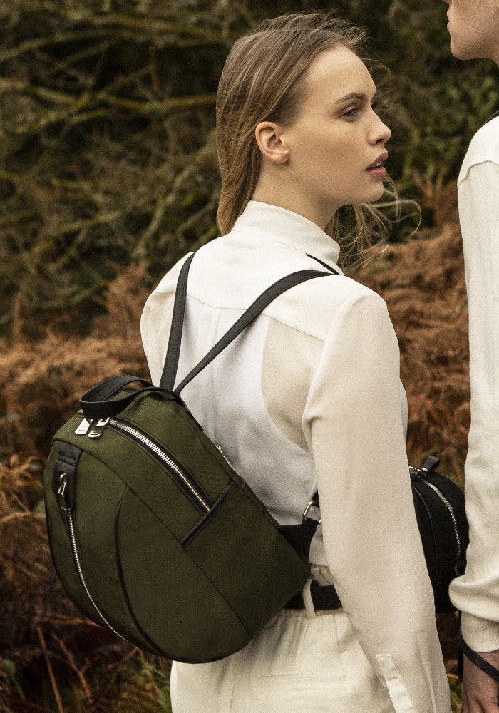 Woman carrying The Gallery Backpack Petite aoifeu00ae color Military green made with ECONYLu00ae regenerated nylon