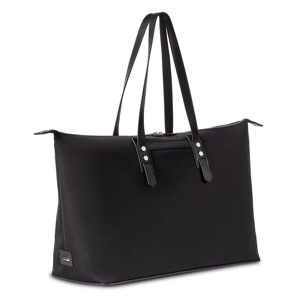 Side view of The Gallery Tote To Backpack aoifeu00ae color Black made with ECONYLu00ae regenerated nylon