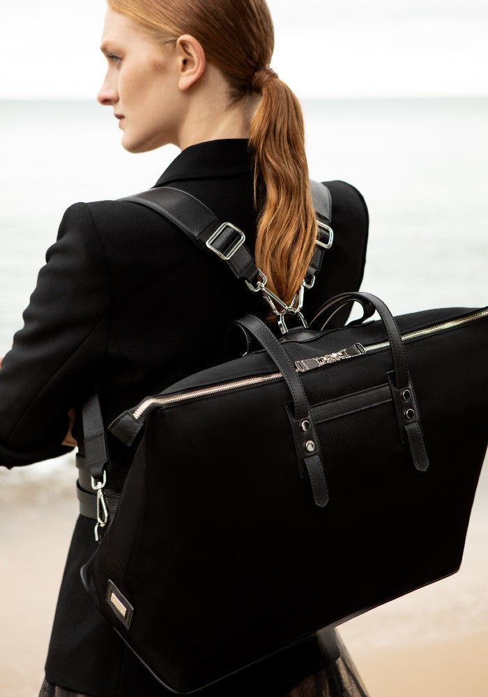 Woman carrying The Gallery Tote To Backpack aoifeu00ae color Black made with ECONYLu00ae regenerated nylon