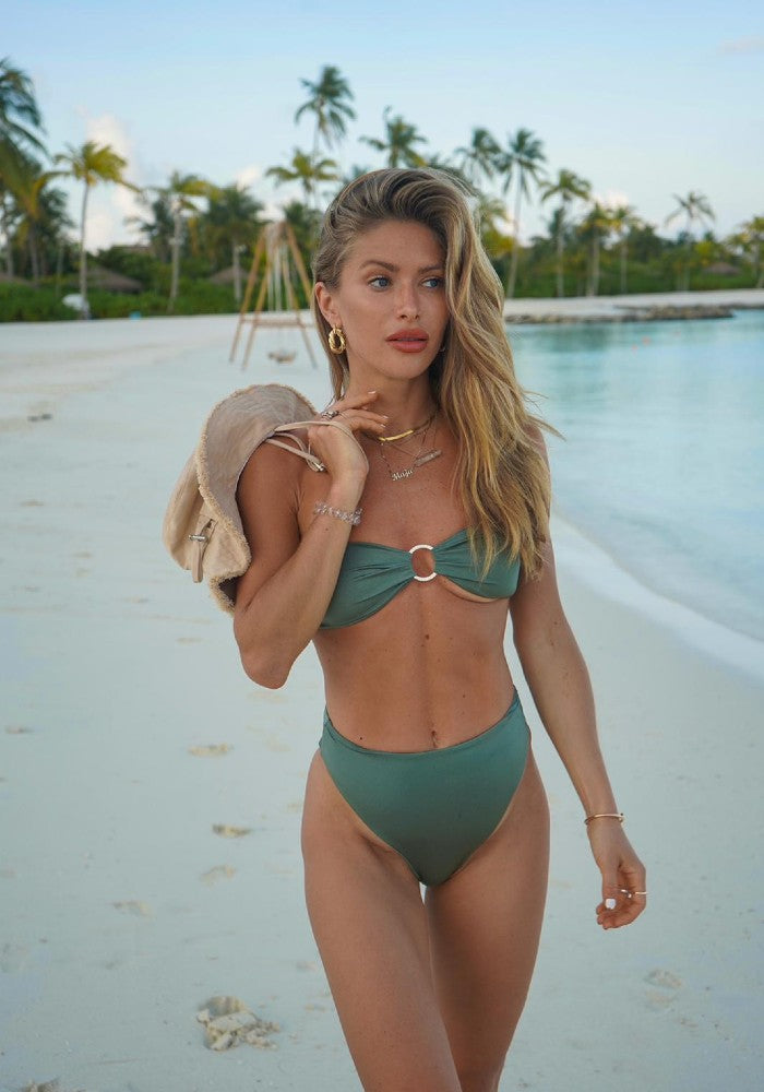 Woman wearing the Amber Satin Top and Bottom Bikini Botanical Beach Babes color Green made with ECONYLu00ae regenerated nylon