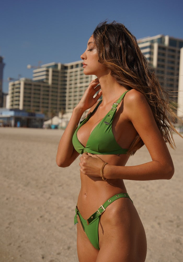 Woman wearing the Tropicana Green Top and Bottom Bikini Botanical Beach Babes color Green made with ECONYLu00ae regenerated nylon