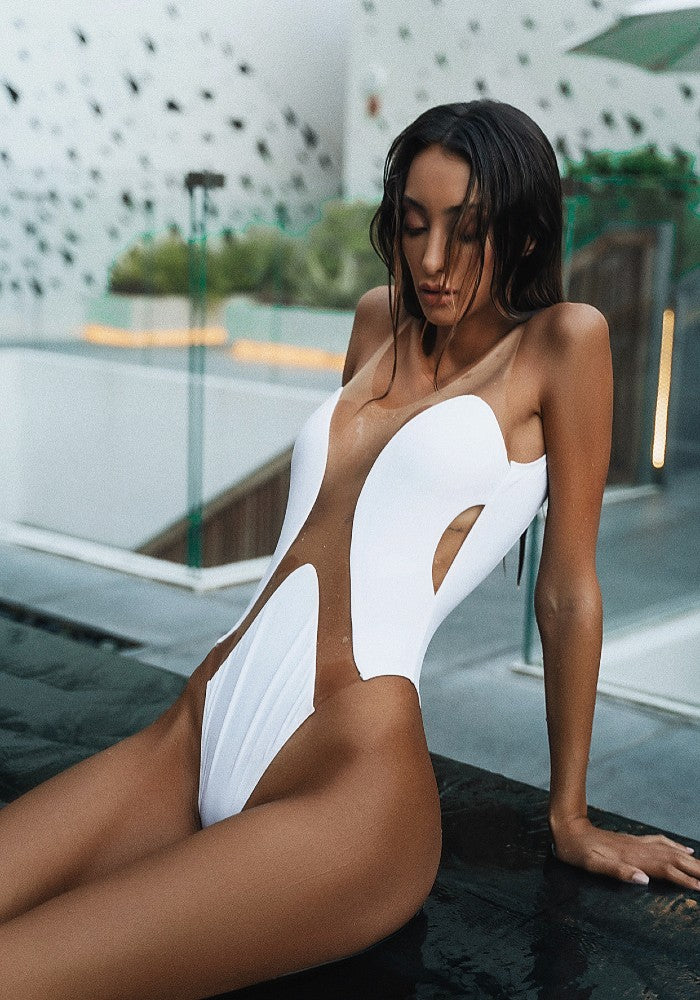 Woman wearing the Elements White One Piece Swimsuit Botanical Beach Babes color White made with ECONYLu00ae regenerated nylon