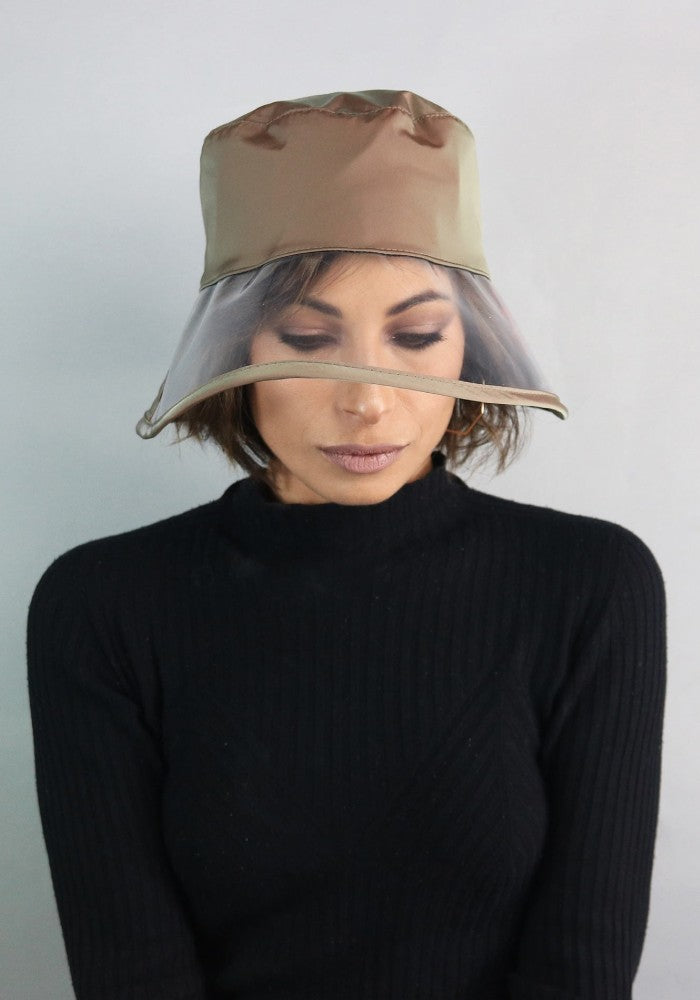 Woman wearing Bau, the waterproof bucket hat by Complit color Green Sage made with ECONYLu00ae regenerated nylon