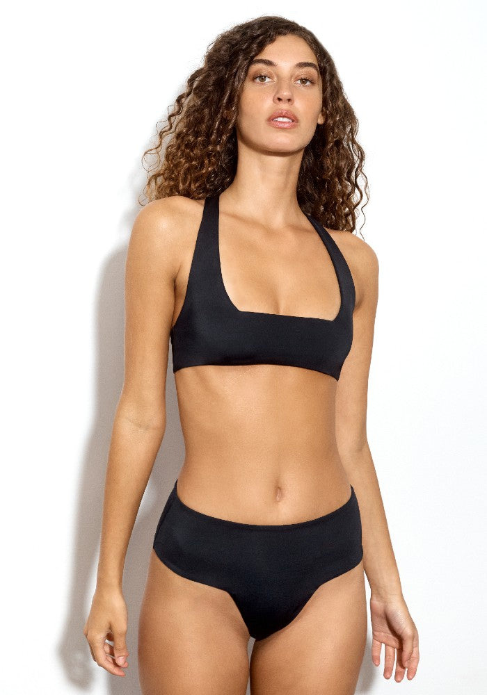Front view of the Lola Square: The Modern Square Cheeky Bikini Bottom by Dos Gardenias color Black made with ECONYLu00ae regenerated nylon