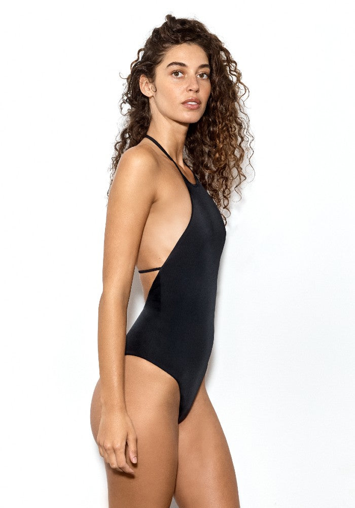 Side view of the Superstar: The T-Back One Piece Swimsuit by Dos Gardenias color Black made with ECONYLu00ae regenerated nylon