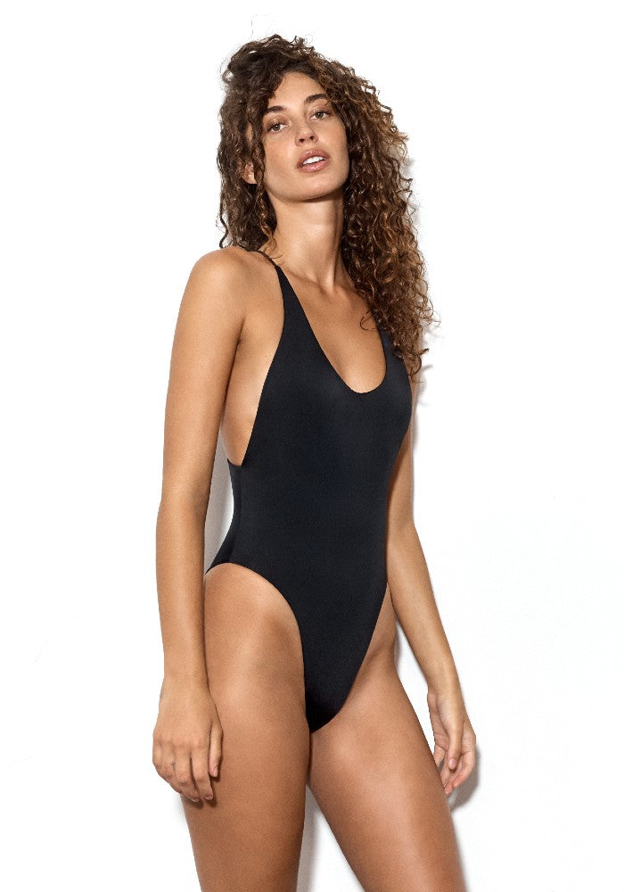 Side view of the Vicious: The Dos Gardenias Signature Suit Swimsuit color Black made with ECONYLu00ae regenerated nylon