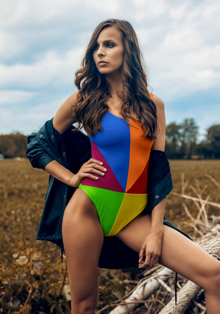 Woman wearing the Arcobaleno Swimsuit Ludovica Gualtieri Milano multicolor made with ECONYLu00ae regenerated nylon