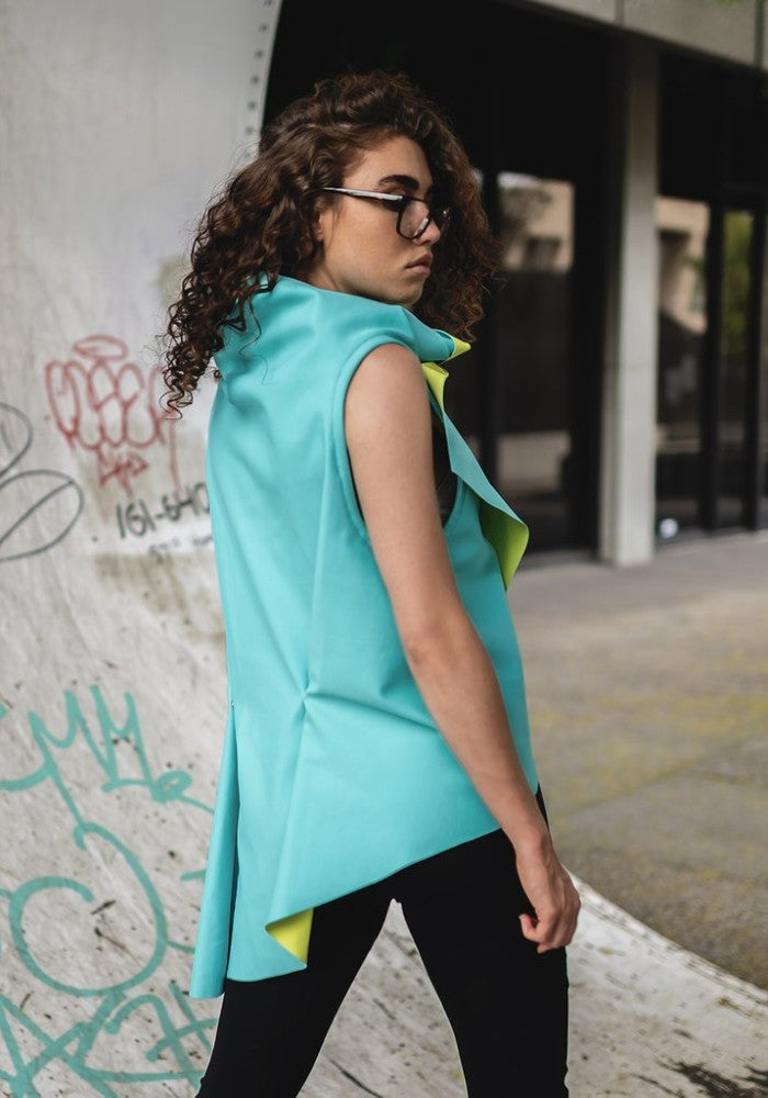 Back view of a woman wearing the Zero Vest Green Malaika New York lifestyle made with ECONYLu00ae regenerated nylon