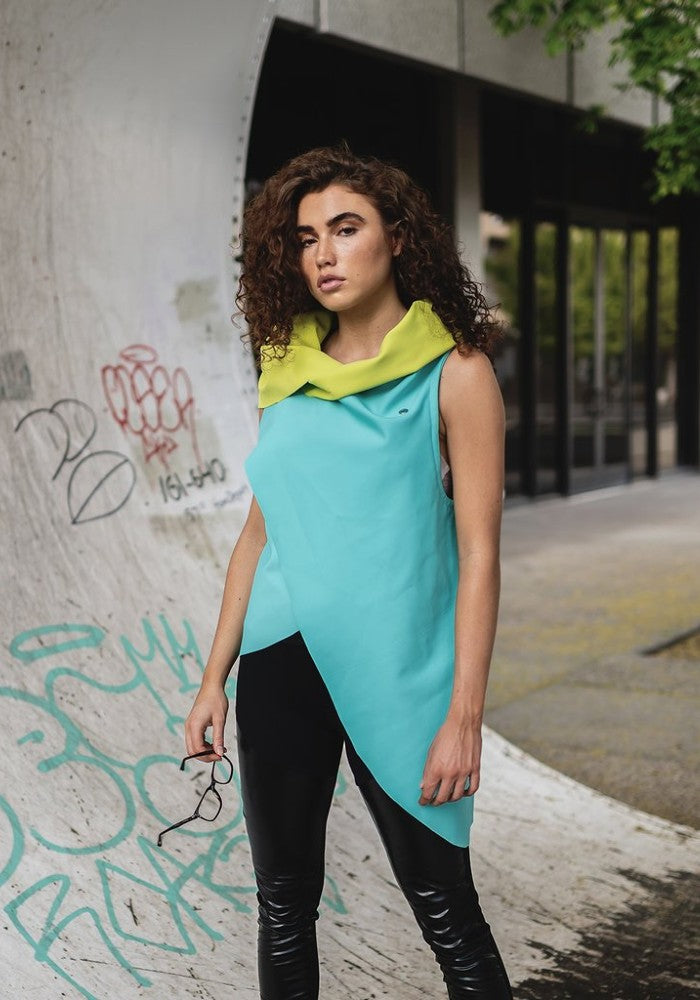 Side view of a woman wearing the Zero Vest Green Malaika New York lifestyle made with ECONYLu00ae regenerated nylon