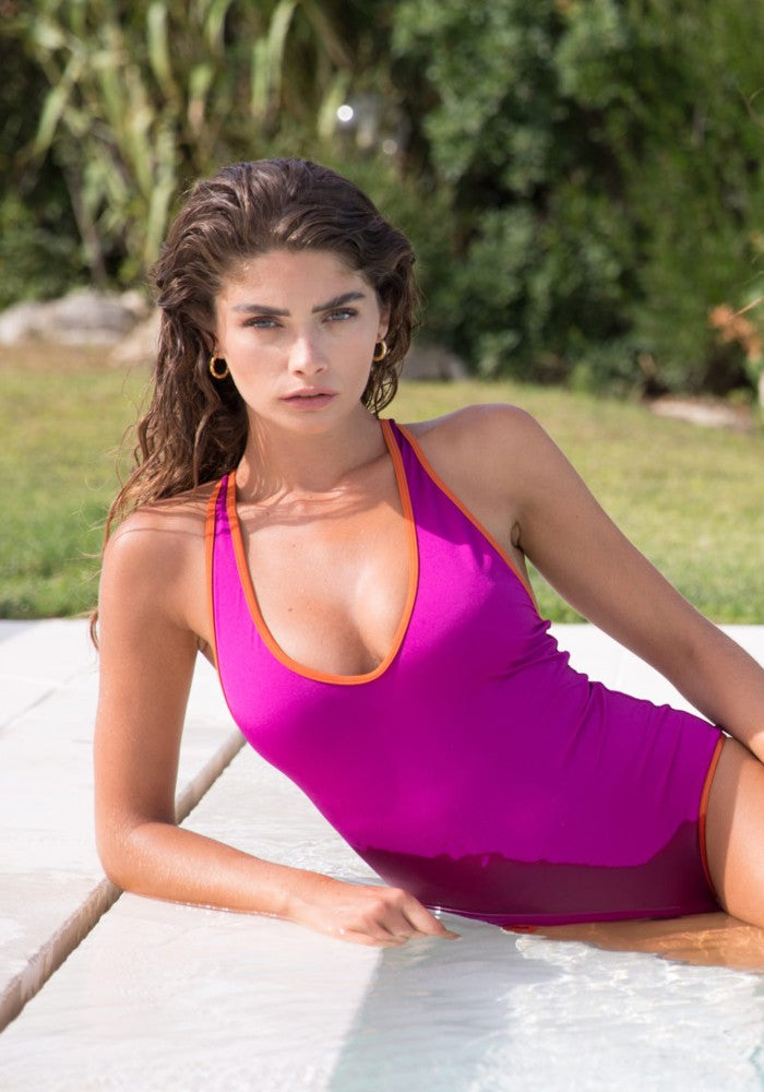 Woman wearing the Diana (Wonder Collection) Swimsuit Mermazing color Fuchsia and Orange made with ECONYLu00ae regenerated nylon
