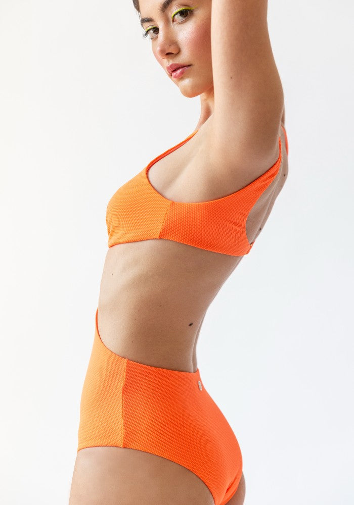 Back view of a woman wearing the Hawaii (Rainbow Collection) Swimsuit Mermazing color Orange made with ECONYLu00ae regenerated nylon