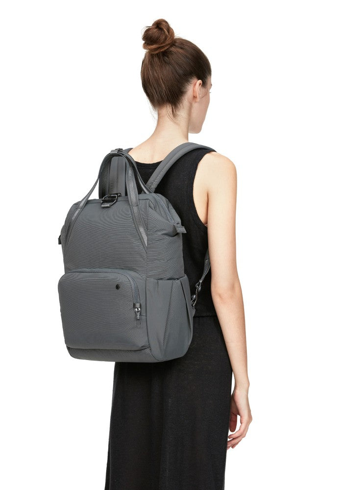 Back view of a woman wearing the Pacsafe Citysafe CX Anti-Theft Backpack color Storm made with ECONYLu00ae regenerated nylon