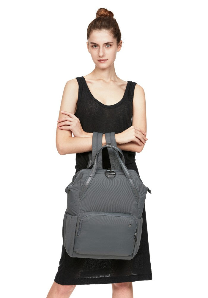 Front view of a woman wearing the Pacsafe Citysafe CX Anti-Theft Backpack color Storm made with ECONYLu00ae regenerated nylon