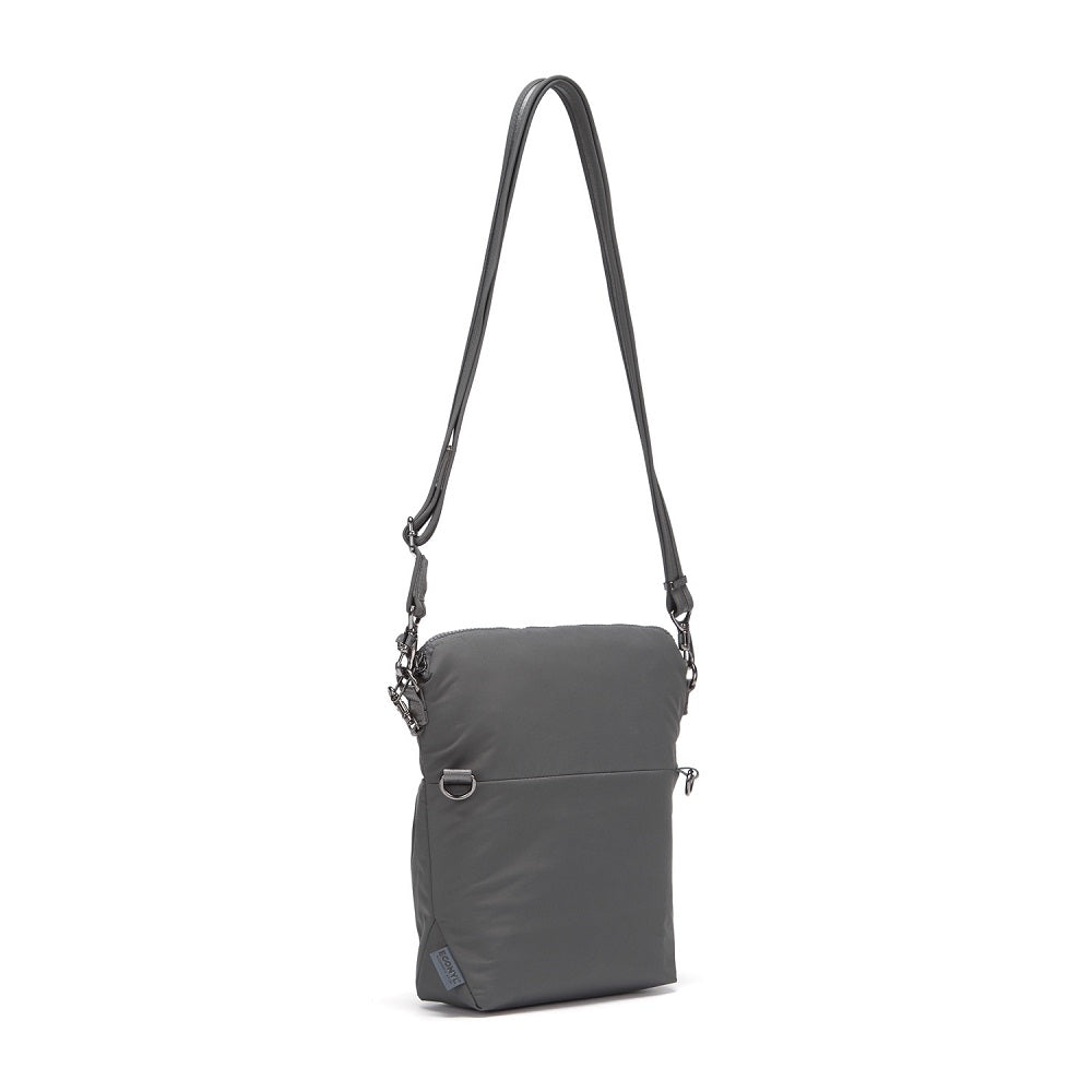Back side view of the Pacsafe Citysafe CX Anti-Theft Convertible Crossbody color Storm made with ECONYLu00ae regenerated nylon extended