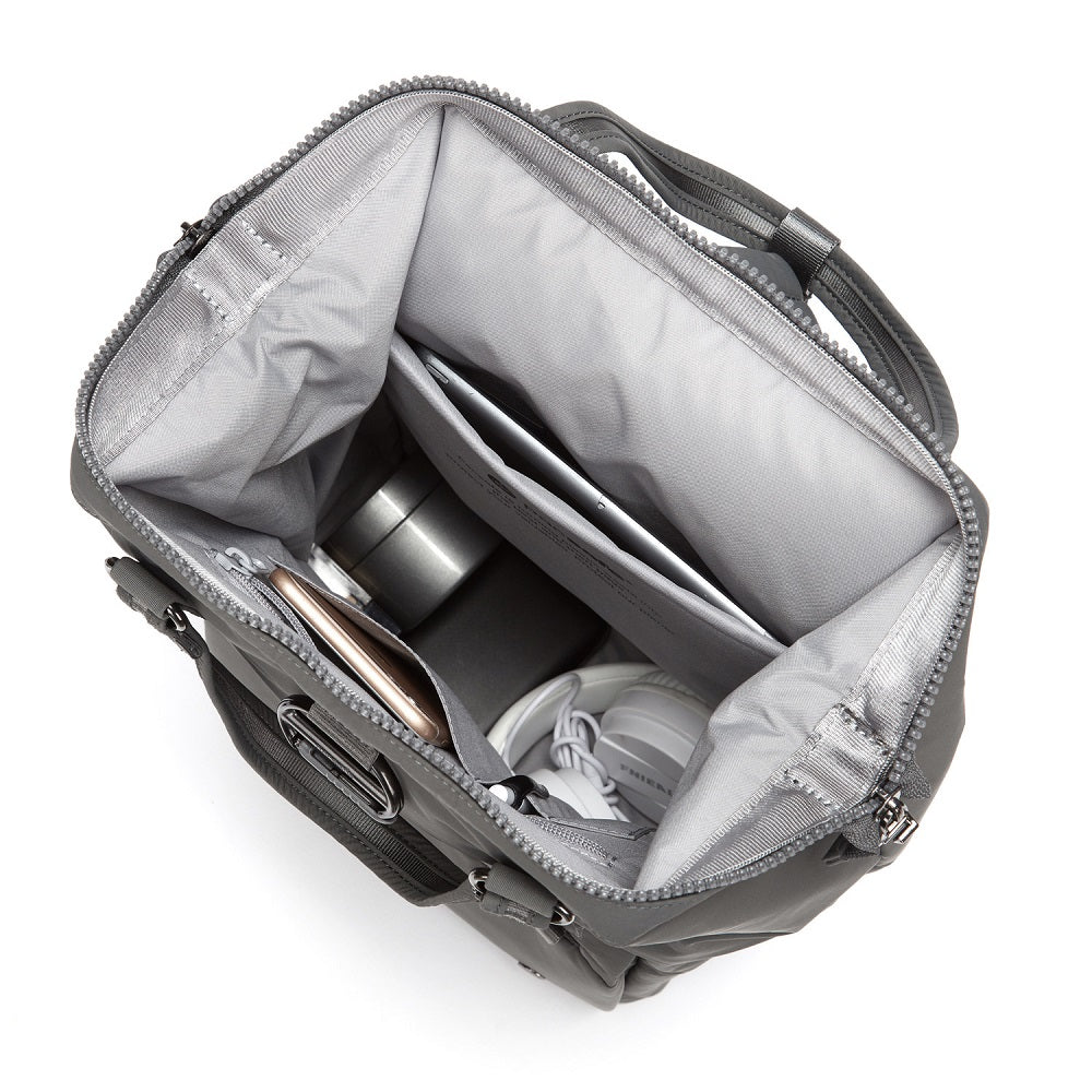 Inside view of the Pacsafe Citysafe CX Anti-Theft Mini Backpack color Storm made with ECONYLu00ae regenerated nylon