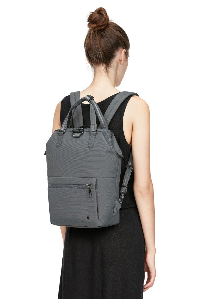 Back view of a woman carrying the Pacsafe Citysafe CX Anti-Theft Mini Backpack color Storm made with ECONYLu00ae regenerated nylon