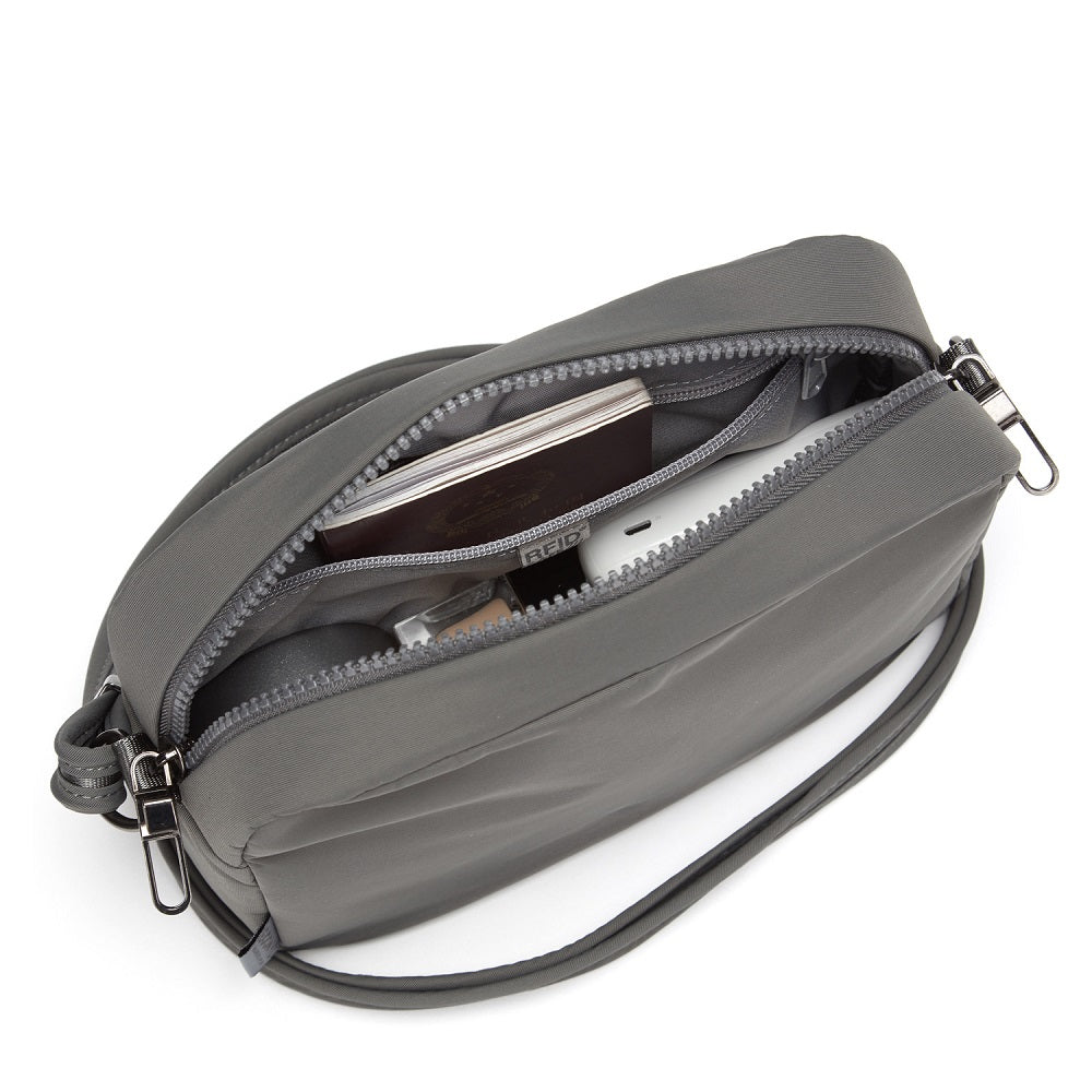 Inside view of the Pacsafe Citysafe CX Anti-Theft Square Crossbody color Storm made with ECONYLu00ae regenerated nylon