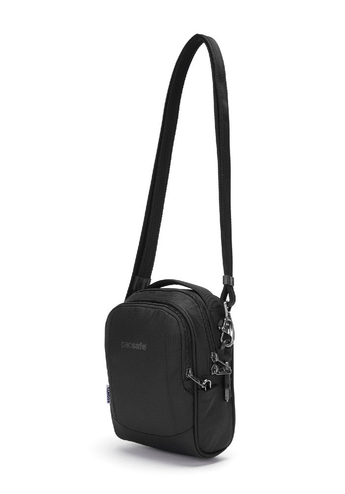 Back side view of the Pacsafe Metrosafe LS100 Anti-Theft Crossbody Bag color Black made with ECONYLu00ae regenerated nylon
