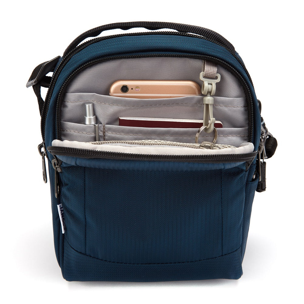 Inside view of the Pacsafe Metrosafe LS100 Anti-Theft Crossbody Bag color Ocean made with ECONYLu00ae regenerated nylon