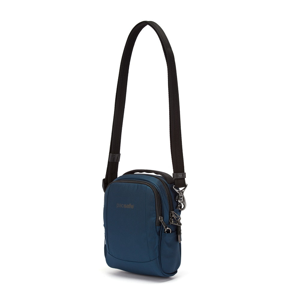Front side view of the Pacsafe Metrosafe LS100 Anti-Theft Crossbody Bag color Ocean made with ECONYLu00ae regenerated nylon