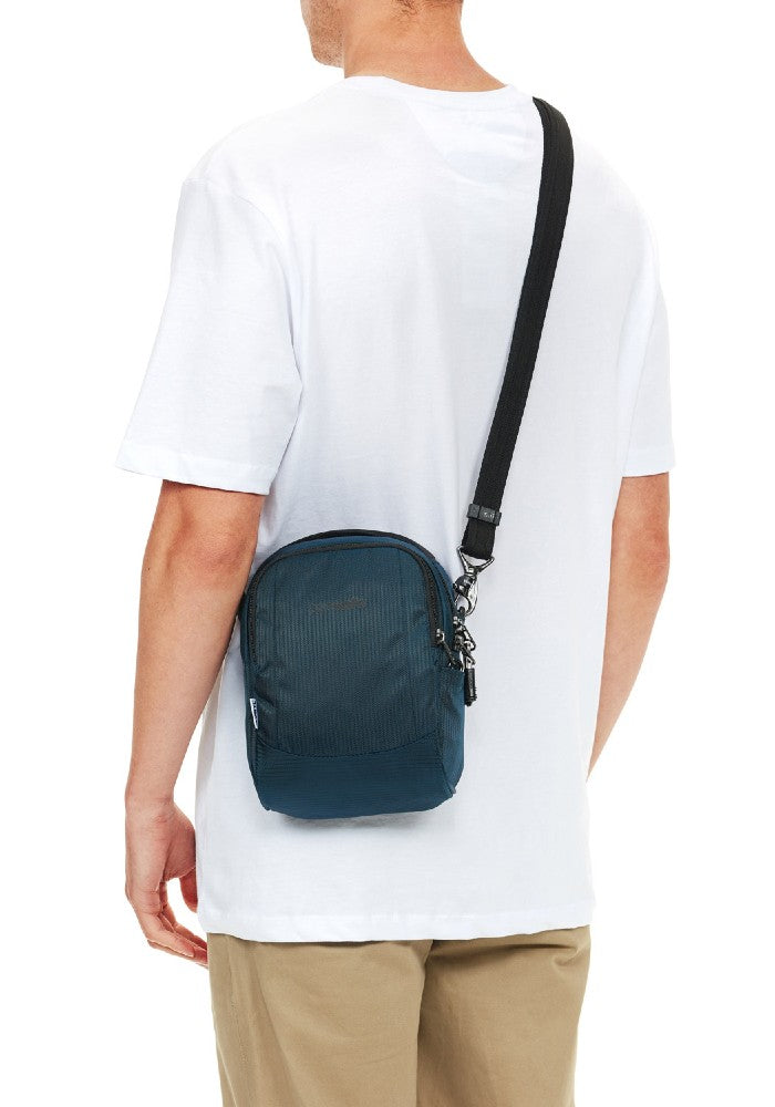 Man carrying the Pacsafe Metrosafe LS100 Anti-Theft Crossbody Bag color Black made with ECONYLu00ae regenerated nylon