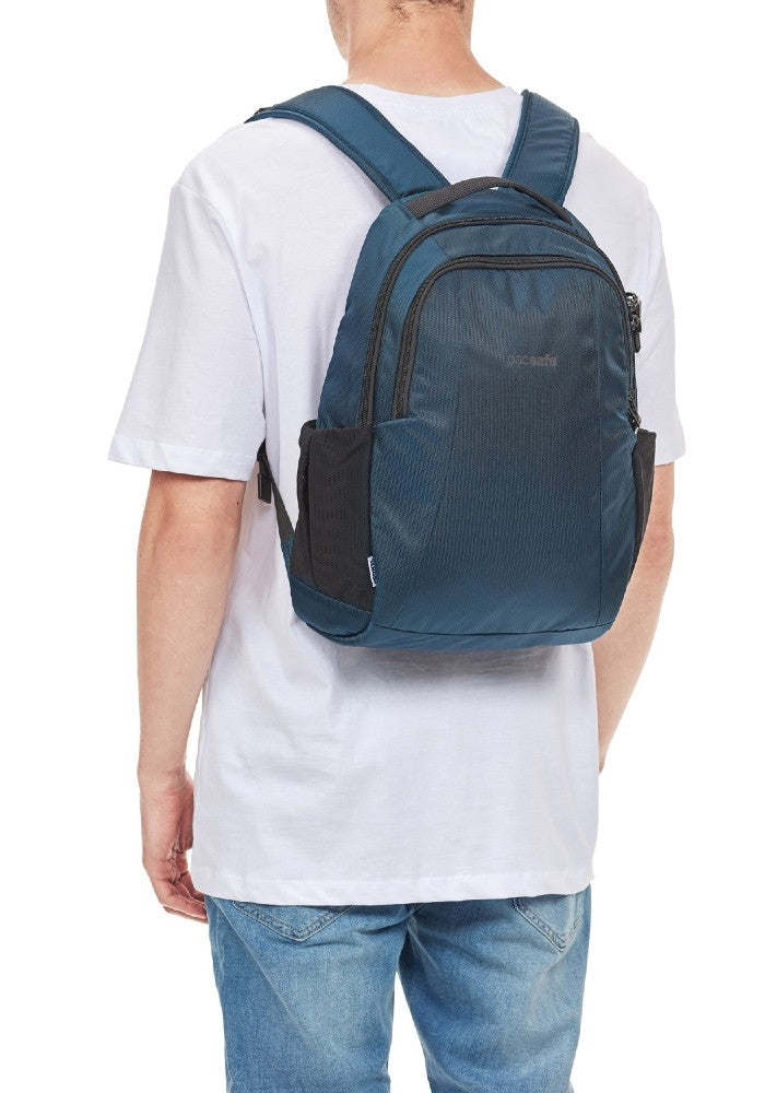 Back side view of a man carrying the Pacsafe Metrosafe LS350 Anti-Theft Backpack color Ocean made with ECONYLu00ae regenerated nylon