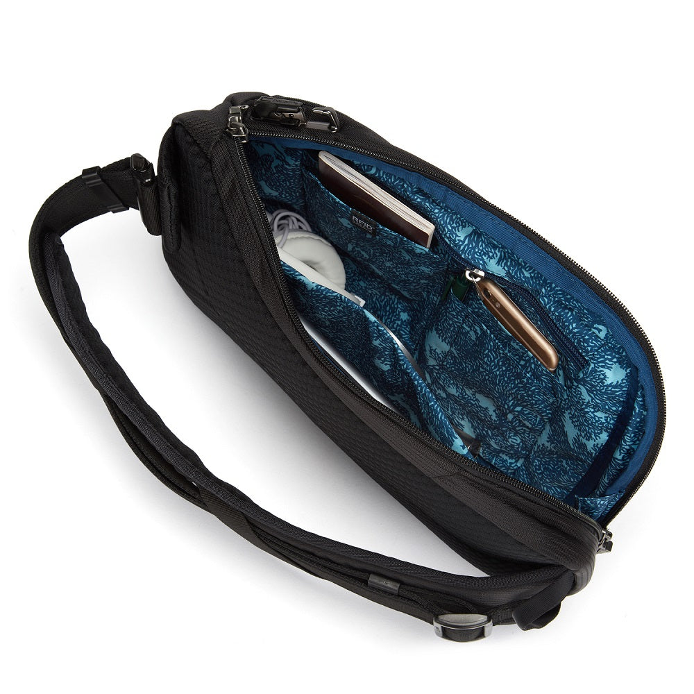 Inside view of the Pacsafe Vibe 325 Anti-Theft Sling Pack color Black made with ECONYLu00ae regenerated nylon