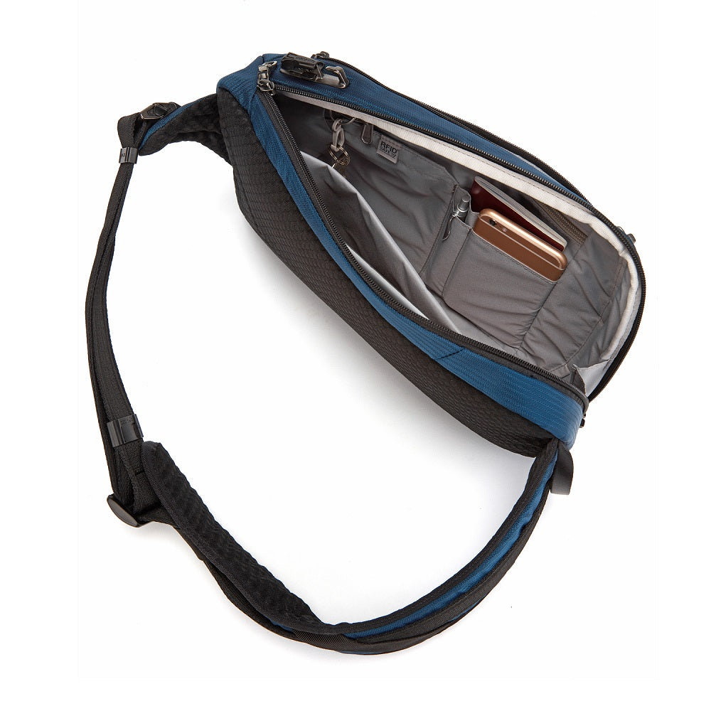 Inside view of the Pacsafe Vibe 325 Anti-Theft Sling Pack color Ocean made with ECONYLu00ae regenerated nylon