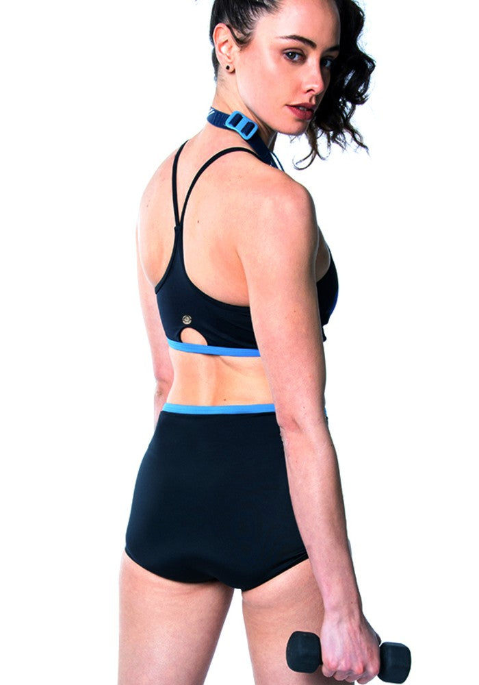 Back view of a woman wearing the Vanna Multi Sports Crop Top RubyMoon GymToSwim color patterned made with ECONYLu00ae regenerated nylon