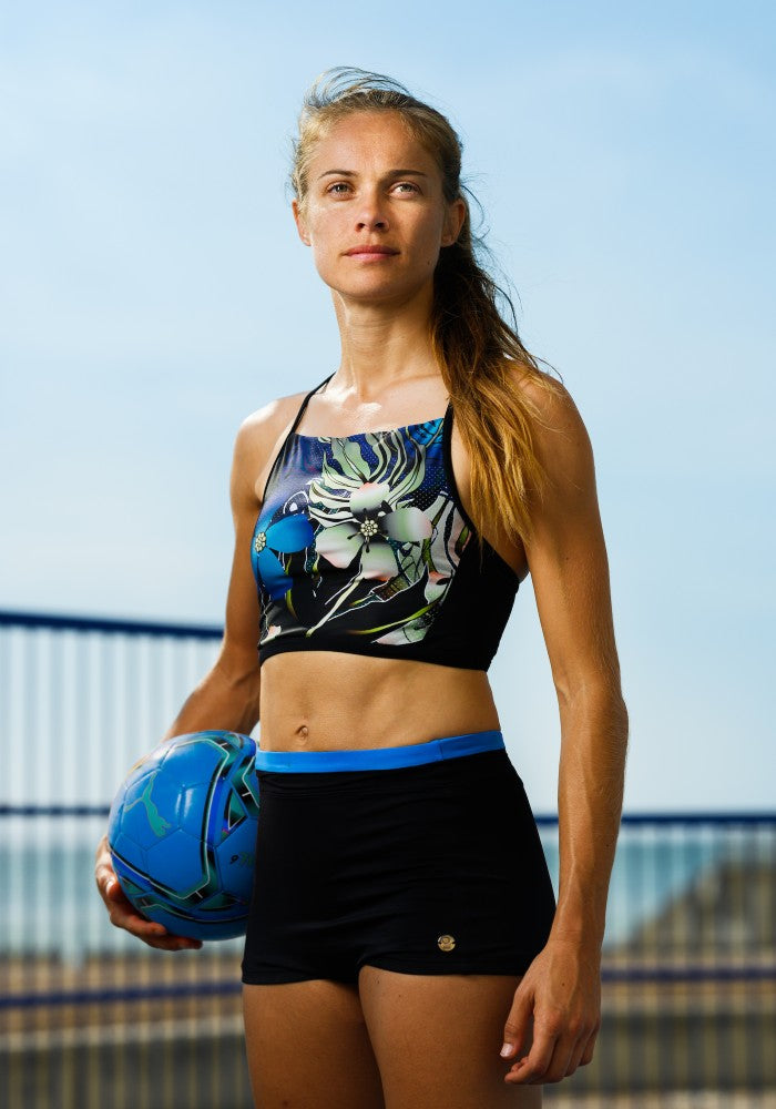 Katie Rood wearing the Vanna Multi Sports Crop Top RubyMoon GymToSwim color patterned made with ECONYLu00ae regenerated nylon