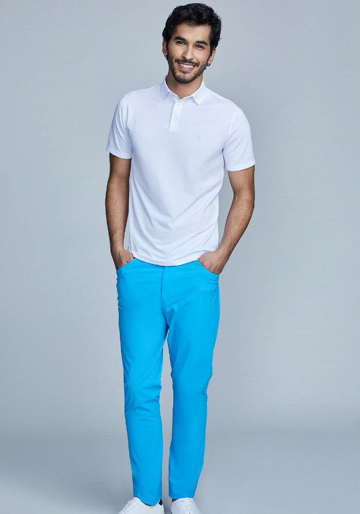 Man wearing The Triton 5-Pocket Pant State Of Matter color Aqua made with ECONYLu00ae regenerated nylon