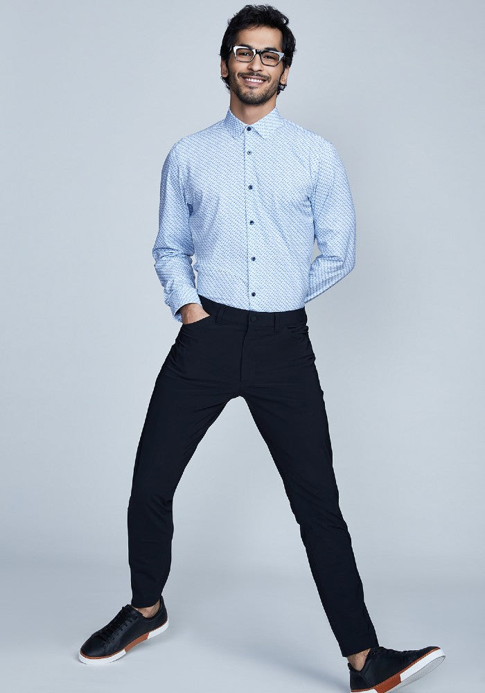 Man wearing The Triton 5-Pocket Pant State Of Matter color Black made with ECONYLu00ae regenerated nylon
