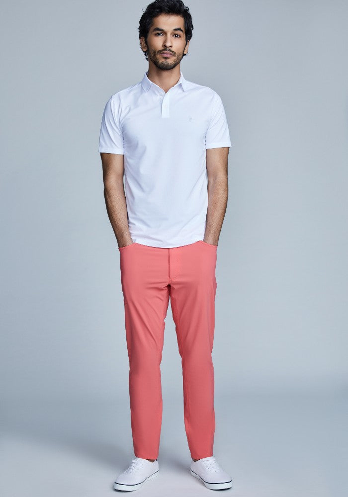 Man wearing The Triton 5-Pocket Pant State Of Matter color Canyon Rose made with ECONYLu00ae regenerated nylon