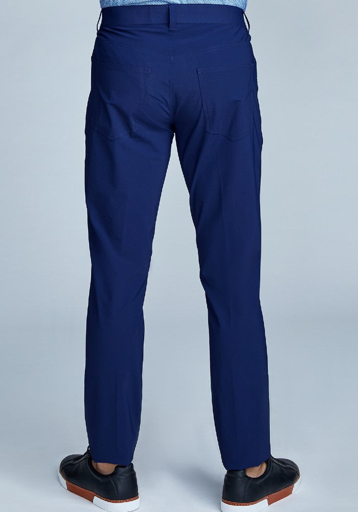 Back view of The Triton 5-Pocket Pant State Of Matter color Deep Navy made with ECONYLu00ae regenerated nylon