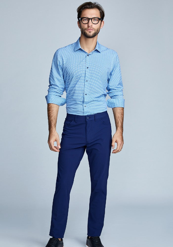 Man wearing The Triton 5-Pocket Pant State Of Matter color Deep Navy made with ECONYLu00ae regenerated nylon
