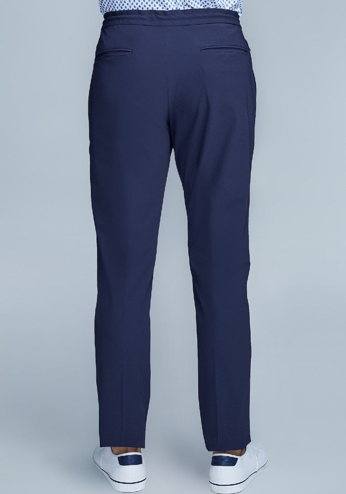 Back view of The Triton Drawstring Pant State Of Matter color Deep Navy made with ECONYLu00ae regenerated nylon