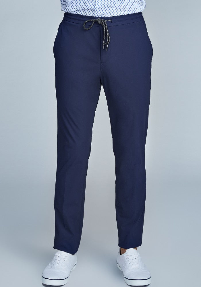 Front view of The Triton Drawstring Pant State Of Matter color Deep Navy made with ECONYLu00ae regenerated nylon