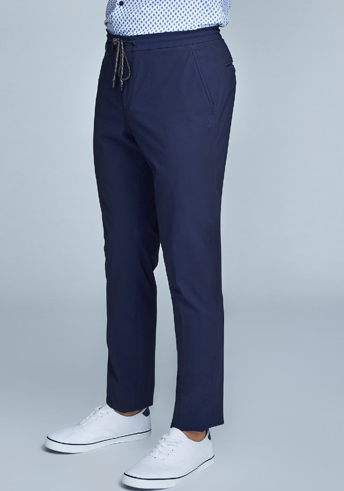 Side view of The Triton Drawstring Pant State Of Matter color Deep Navy made with ECONYLu00ae regenerated nylon
