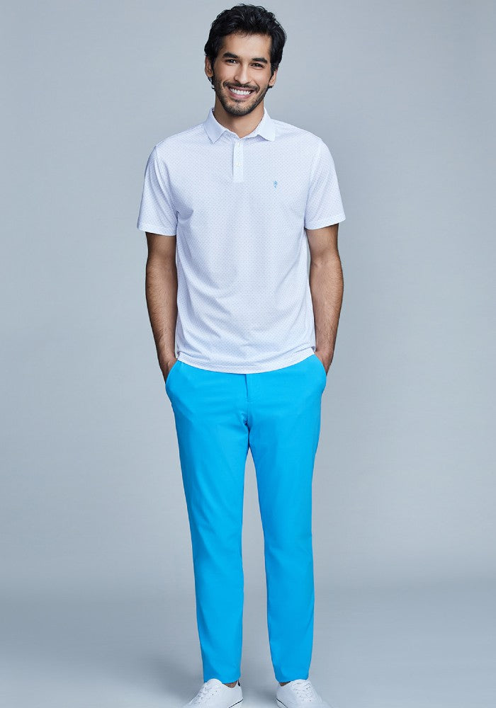 Man wearing The Triton Pant State Of Matter color Aqua made with ECONYLu00ae regenerated nylon