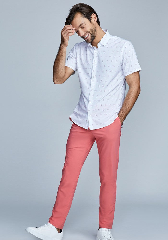 Man wearing The Triton Pant State Of Matter color Canyon Rose made with ECONYLu00ae regenerated nylon