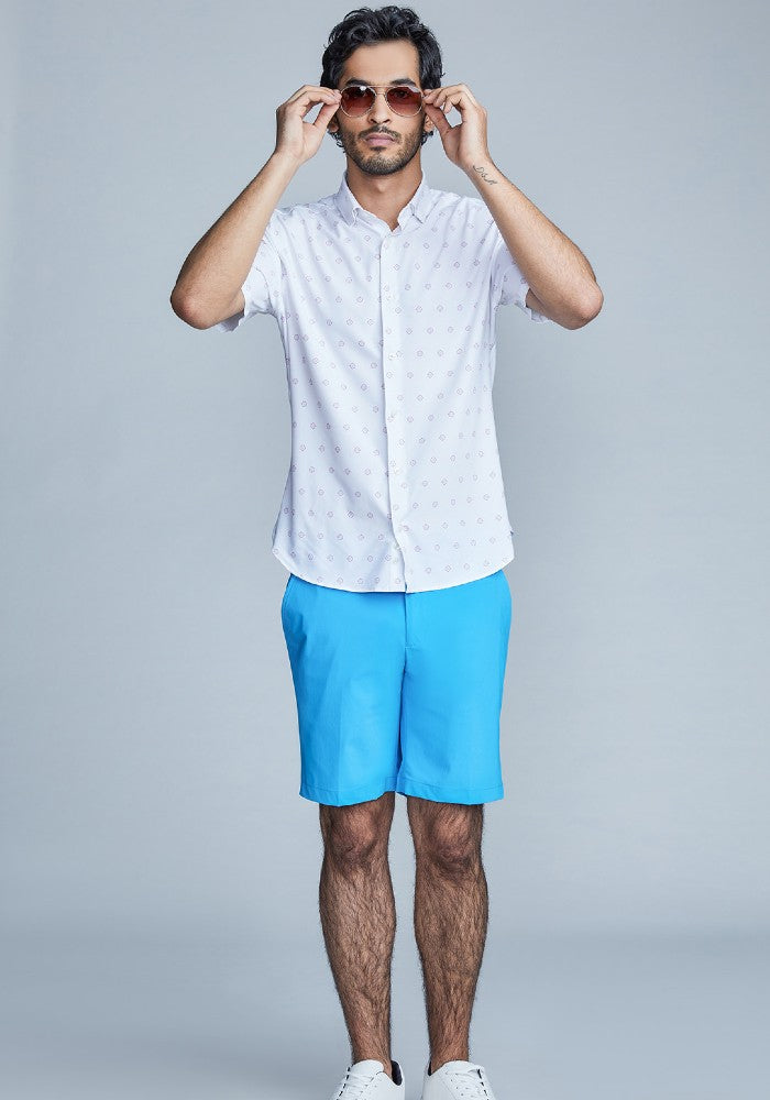 Man wearing The Triton Short Pant State Of Matter color Aqua made with ECONYLu00ae regenerated nylon