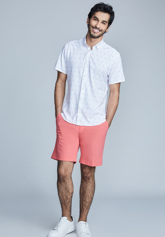 Man wearing The Triton Short Pant State Of Matter color Canyon Rose made with ECONYLu00ae regenerated nylon