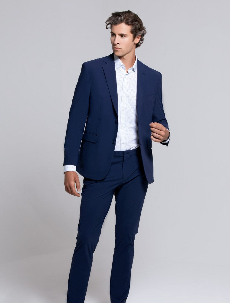 The Triton Suit Jacket State Of Matter color Blue made with ECONYLu00ae regenerated nylon lifestyle