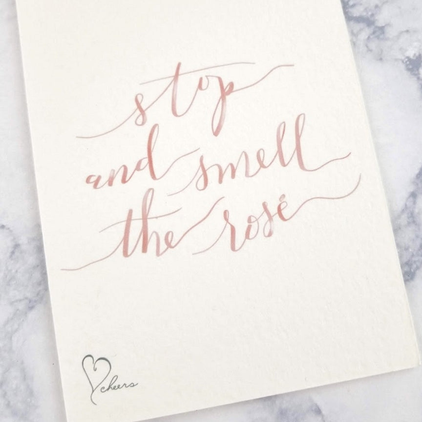 Stop and smell the rose greeting card. A reminder to take a break every now and then.
