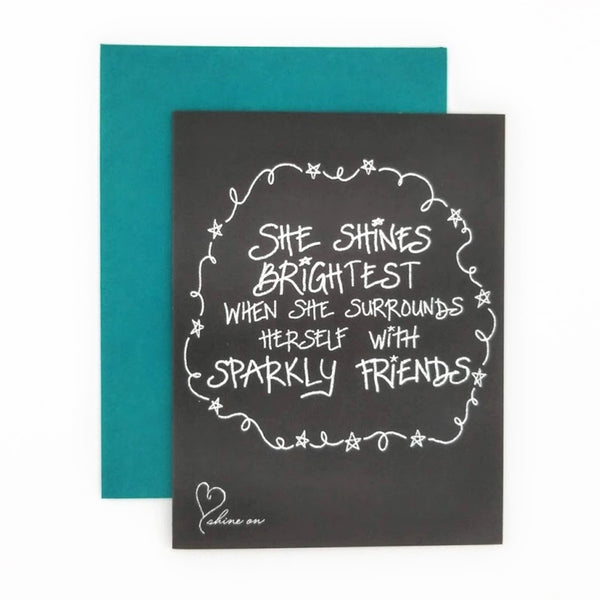 She Shines Brightest When She Surrounds Herself with Sparkly Friends Greeting Card. Hand-lettered chalkboard art design on the front, blank inside and story on the back.