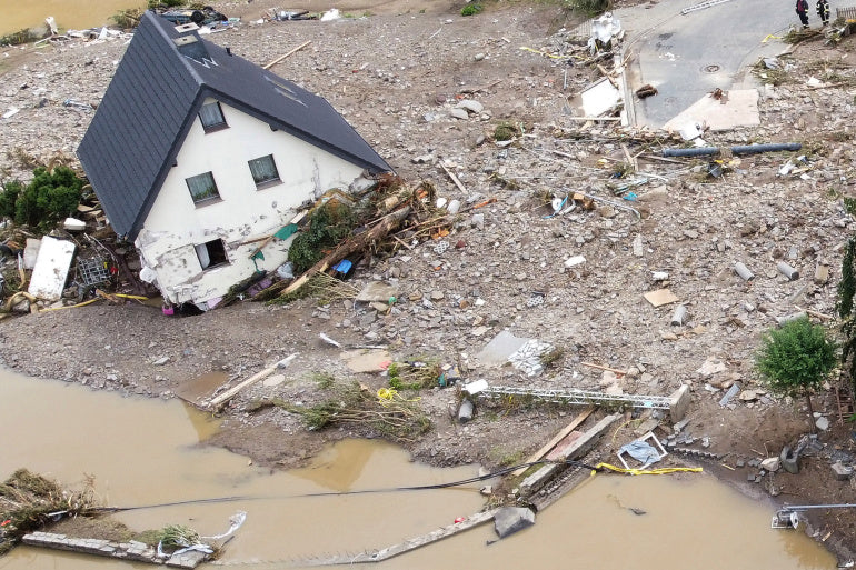 House being swept away due to flooding in Germany