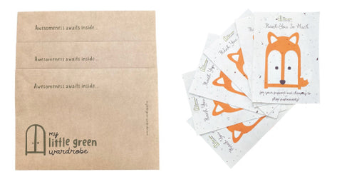 My Little Green Wardrobe's recycled brown paper envelopes featuring the text 'Awesomeness awaits inside...' and a pile of the thank you notes included with every order featuring My Little Green Wardrobe's Todd mascot on seeded paper