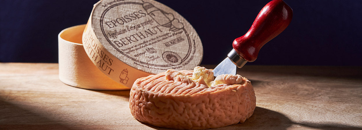 Cheese with knife in the middle
